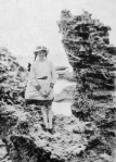 Peggy Beatty on rocks at Anglesea, Victoria, c. 1918