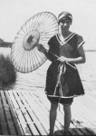 Hilda McLean Forster in bathing costume with parasol on the waterfront at Anglesea, Victoria c. 1922