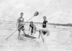 Harold Beatty and Peggy Beatty with paddle boat on the beach at Mentone, Victoria, c. 1925