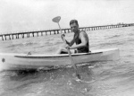 Harold Beatty paddling a boat beside Mentone Pier c. 1925
