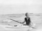 Peggy Beatty paddling a boat at Mentone, Victoria c. 1925